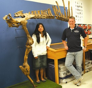 Odulia Flores and Woodburn Science Teacher David Ellingston with school fossil project