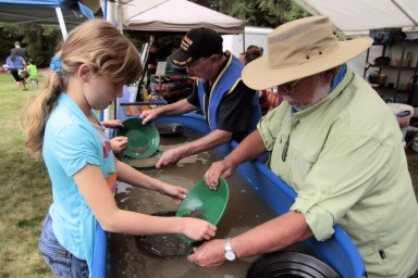 Gold panning with children and rock club members.